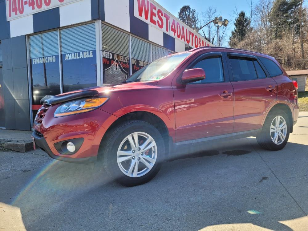 2010 RED Hyundai Santa Fe SE 3.5 AWD (5NMSHDAG2AH) with an 3.5L V6 DOHC 24V engine, 6-Speed Automatic transmission, located at 250 Glenn Highway, Cambridge, OH, 43725, (740) 439-5504, 39.994991, -81.716339 - Photo #0
